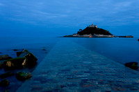 "The high tide covers the causeway leading to the island of St. Michael's Mount, Cornwall, shown here in the ""Blue Hour"" after sunset."